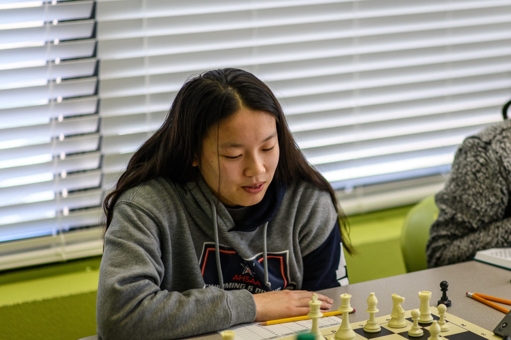 Constance Wang playing chess