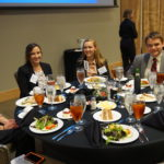 Scholarship recipients smile at dinner.